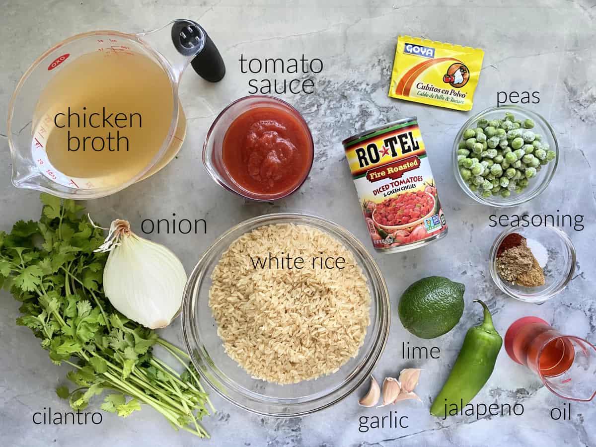 Ingredients: broth, onion, cilantro, tomato sauce, white rice, garlic, lime, jalapeno, oil, seasoning, peas, rotel, and goya.