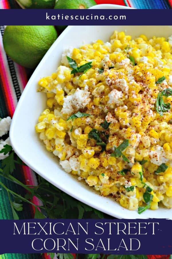 Close up of a white bowl filled with Mexican Street Corn Salad with recipe title text on image.