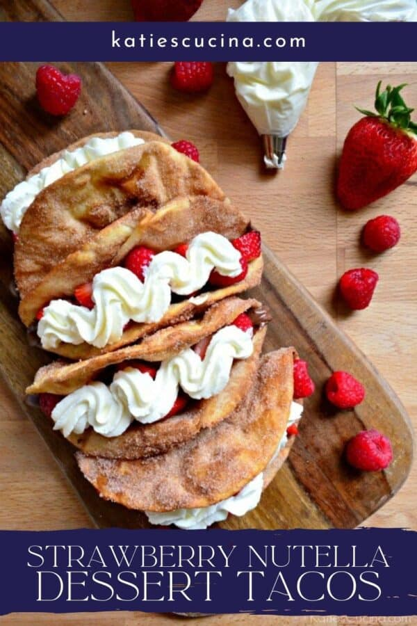 Top view of a wooden board with Strawberry Nutella Dessert Tacos with recipe title text on image.