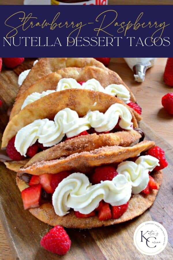 Close up of Strawberry Nutella Dessert Tacos on a wooden cutting board with recipe title text on image.
