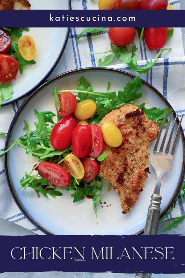 Top view of a white plate with arugula salad, chicken breast and grape tomatoes with text on image for Pitnerest.