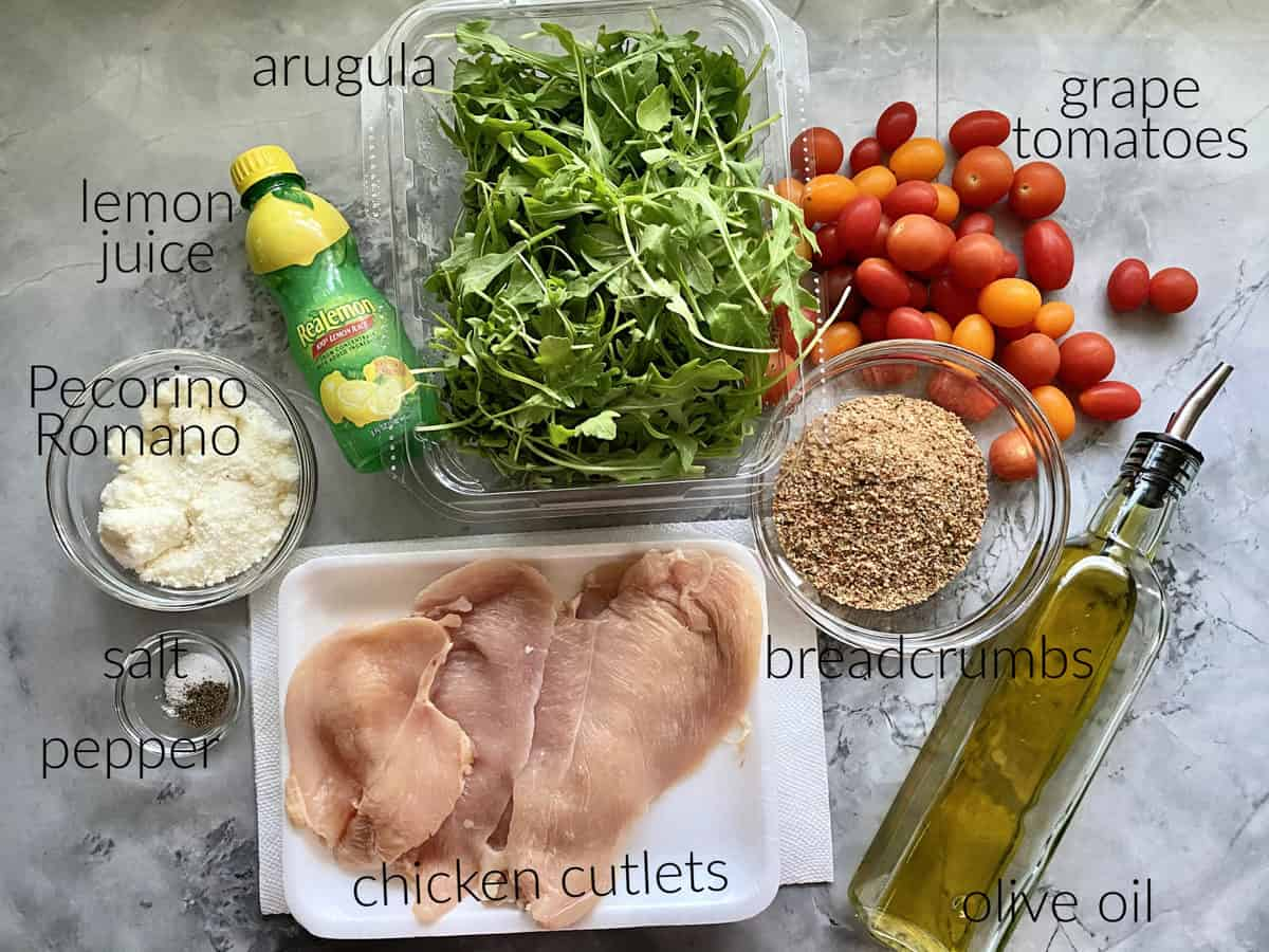 Ingredients: chicken cutlets, salt, pepper, oil, lemon juice, argula, tomatoes, breadcrumbs, and pecorino romano cheese.
