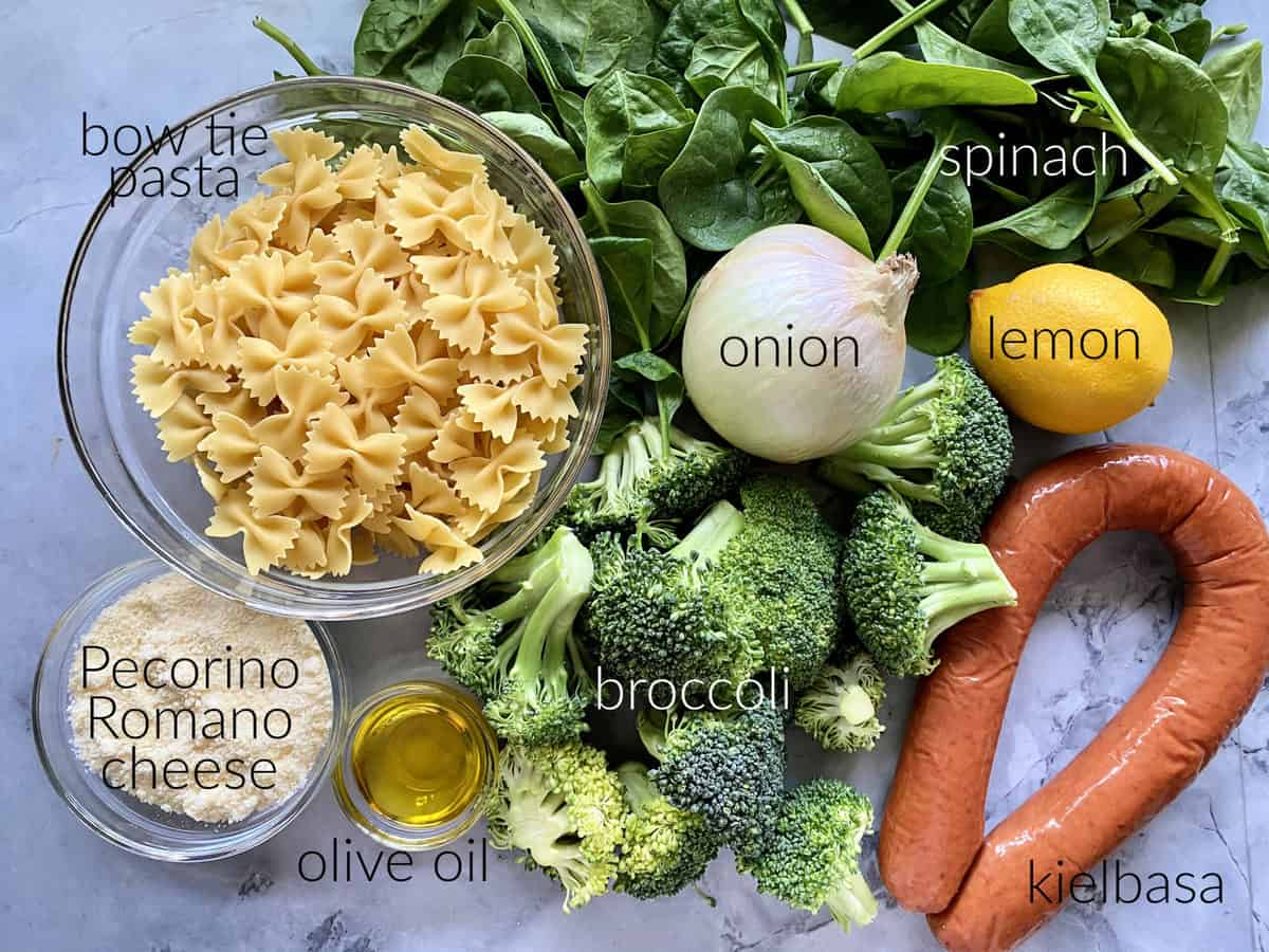Ingredients: bow tie pasta, pecorinio romano cheese, olive oil, broccoli, onion, spinach, lemon, and kielbasa.