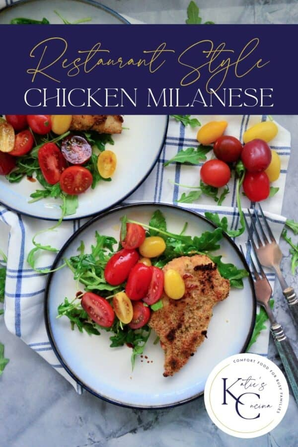 Top view of two plates of chicken breast on a white plate with salad and text on image for Pinterest.