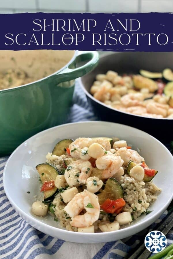 White bowl filled with risotto, seafood, and vegetables with text on image for Pinterest.