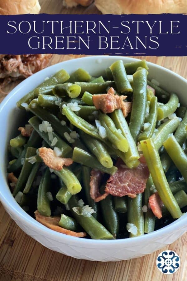 White bowl filled with cooked green beans and bacon with recipe title text on image.