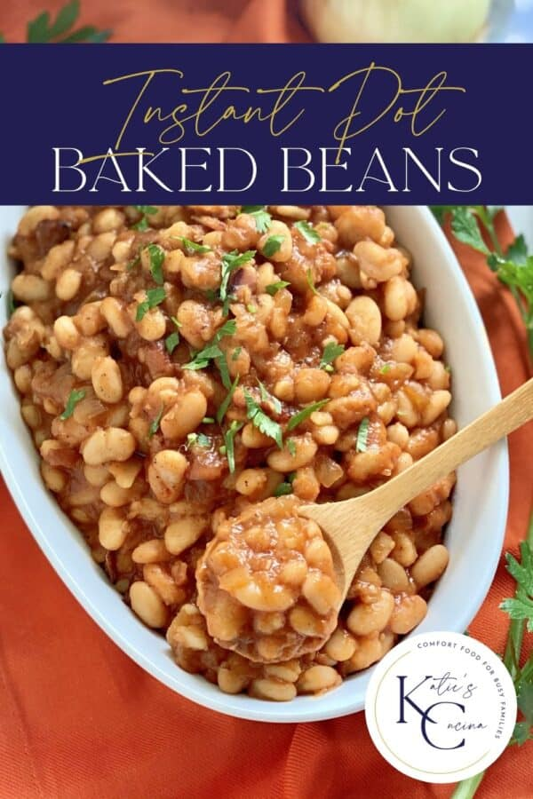Top view of a bowl of baked beans with a spoon in it and text on image for Pinterest.