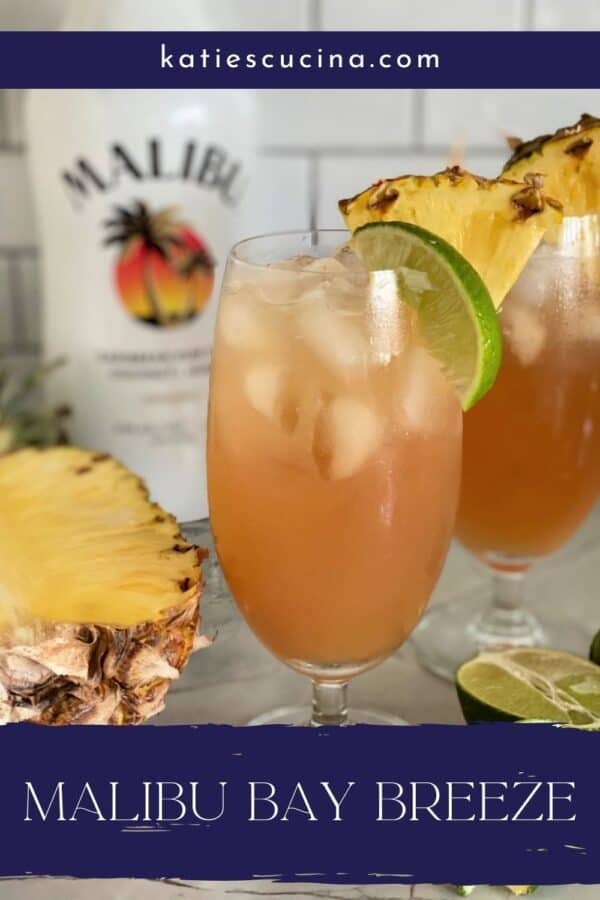 Two glasses of bay breeze with Malibu Rum with text on image for Pinterest.