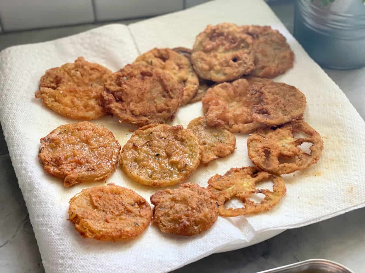 Paper towels on plate with Fried Green Tomatoes.
