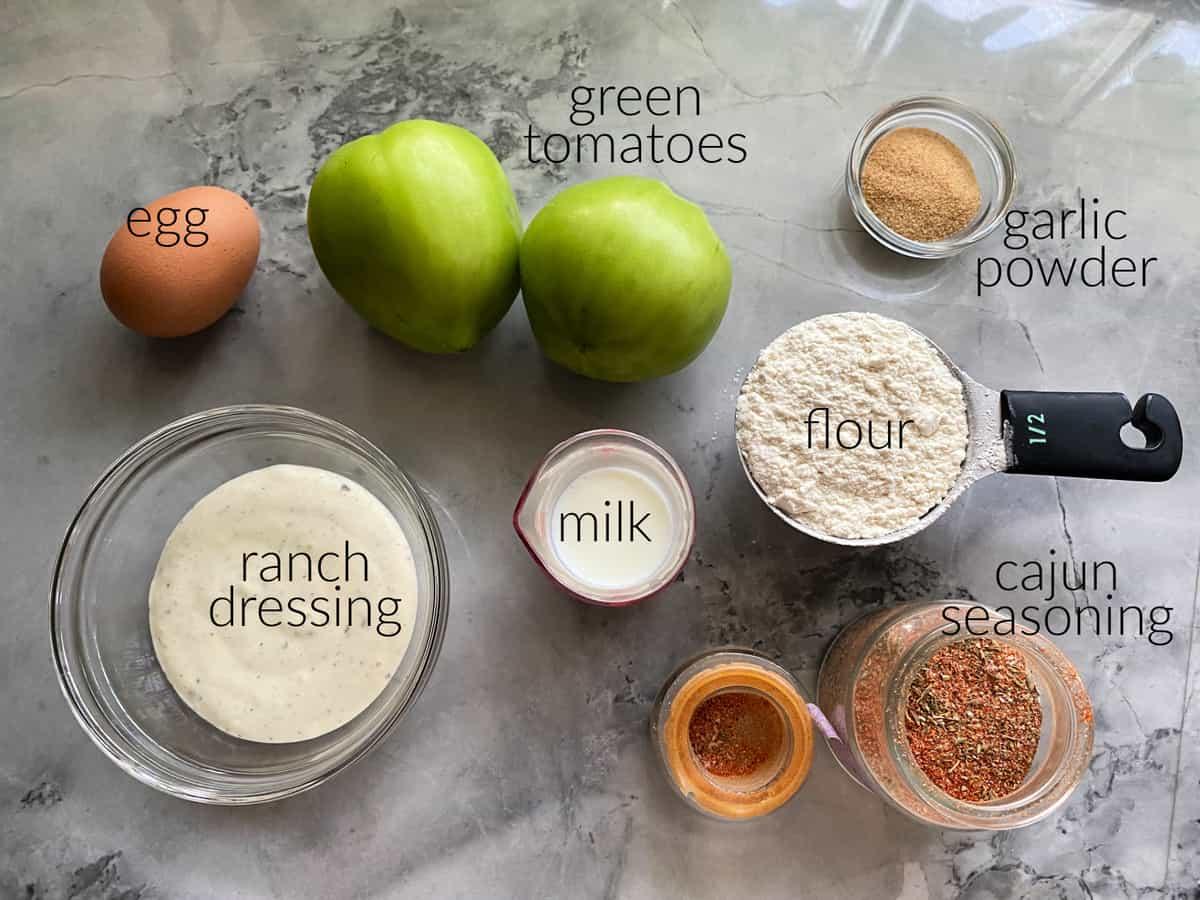 Ingredients: ranch, egg, green tomatoes, garlic powder, milk, cajun seasoning, and flour.