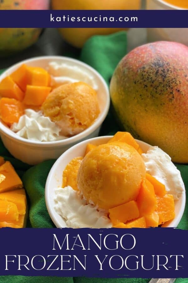 Two white dishes filled with Mango Frozen Yogurt on a green cloth with recipe title text on image for Pinterest.