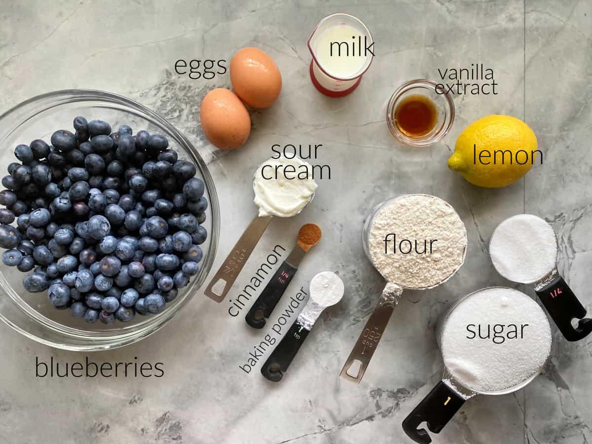 Ingredients: Blueberries, eggs, sour cream, cinnamon, baking powder, flour, sugar, lemon, vanilla extract, and milk.