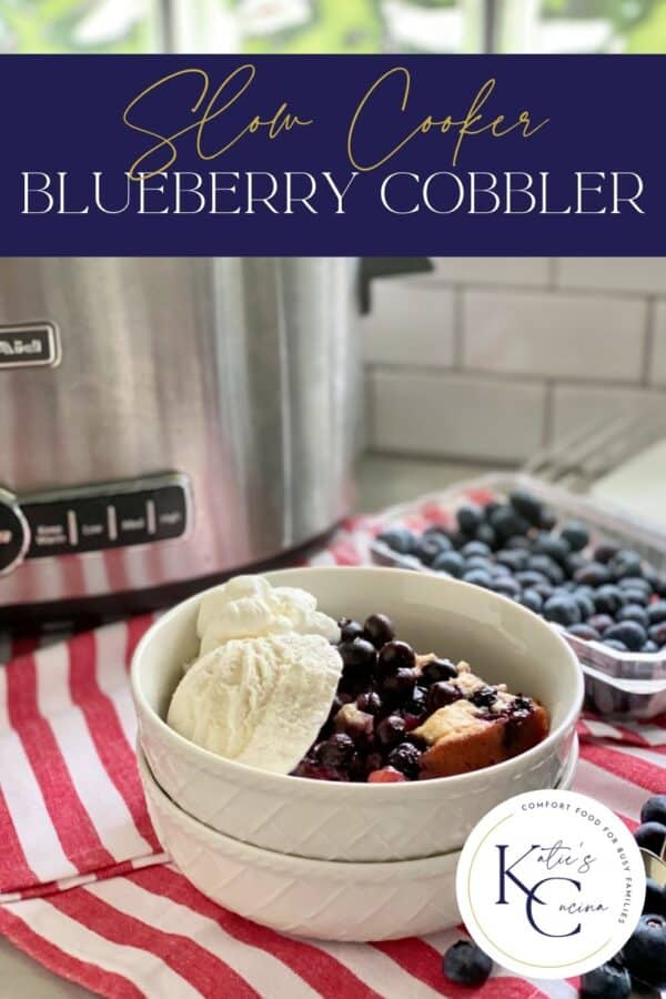 White bowls stacked with blueberry cobbler and recipe title text on image for Pinterest