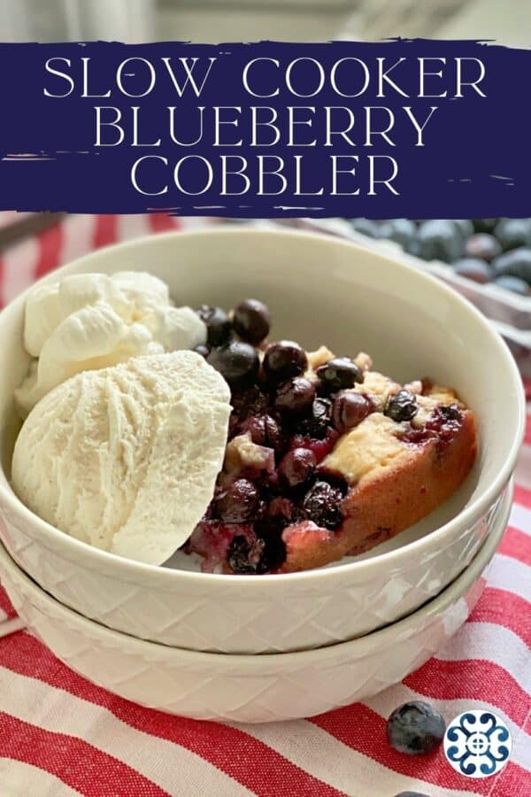 Two bowls stacked with blueberry cobbler and ice cream with recipe title text on image for Pinterest.