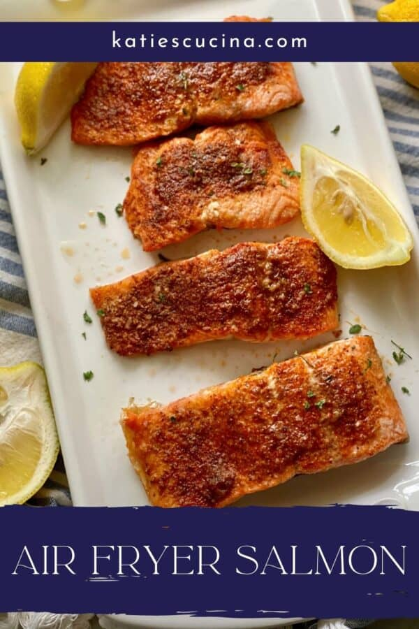 Top view of a white platter filled with 4 salamon filets with recipe title text on image.