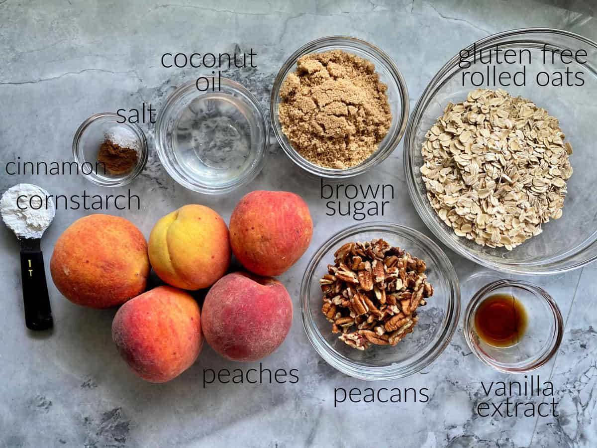 Ingredients: peaches, cornstarch, cinnamon, salt, coconut oil, brown sugar, pecans, gluten free rolled oats, and vanilla extract.