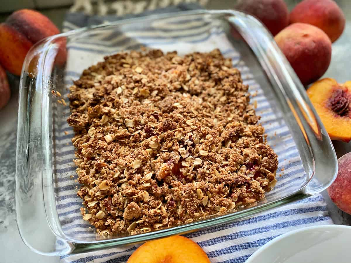 Square glass baking dish with crisp topping.