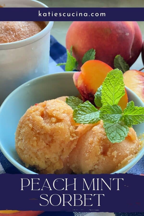 Blue bowl filled with peach sorbet with fresh peaches in background with recipe title text on image for Pinterest.