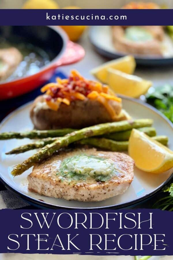 White plate filled with a swordfish steak topped with herb butter, lemon wedge, asparagus, and baked potato with text on image for Pinterest.