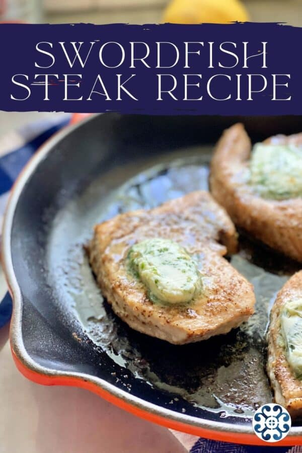 Orange cast iron skillet with 3 swordfish steaks topped with herb butter and text on image for Pinterest.