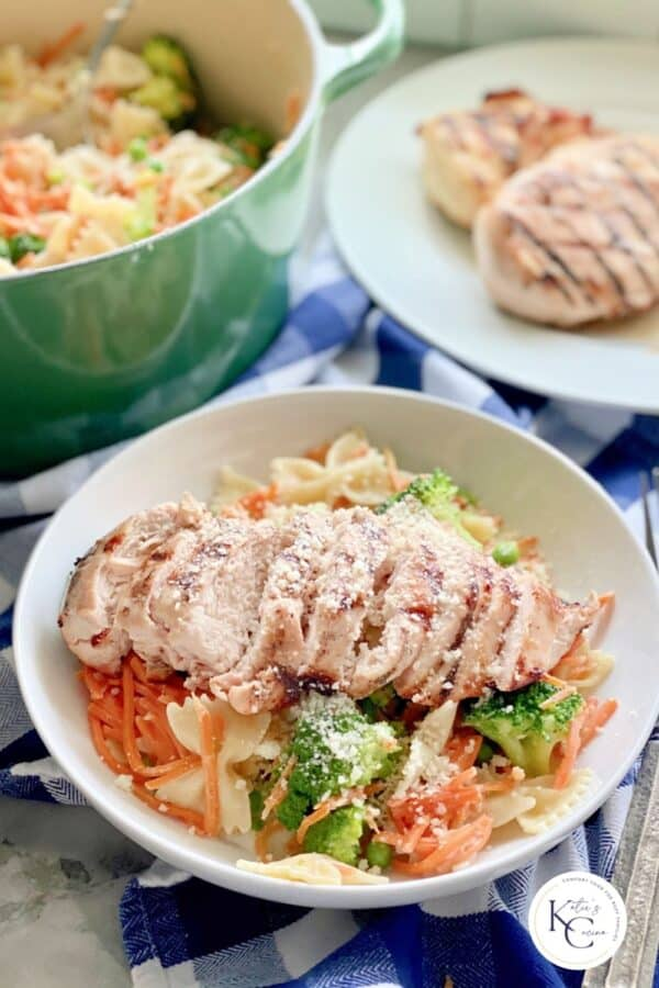 Close up of Grilled Chicken Pasta with veggies in a bowl with watermark on right bottom corner.
