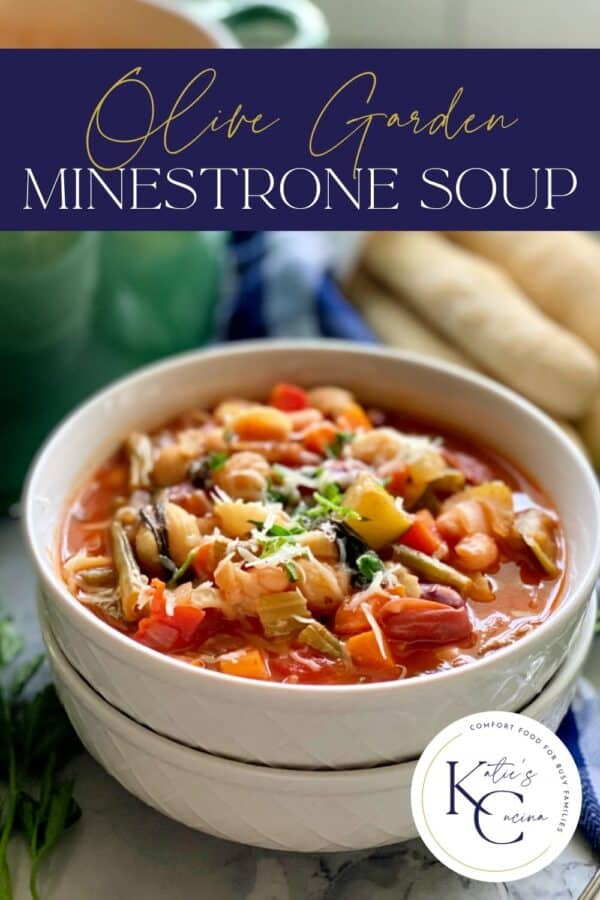 White bowls stacked with minestrone soup with recipe title text on image for Pinterest.