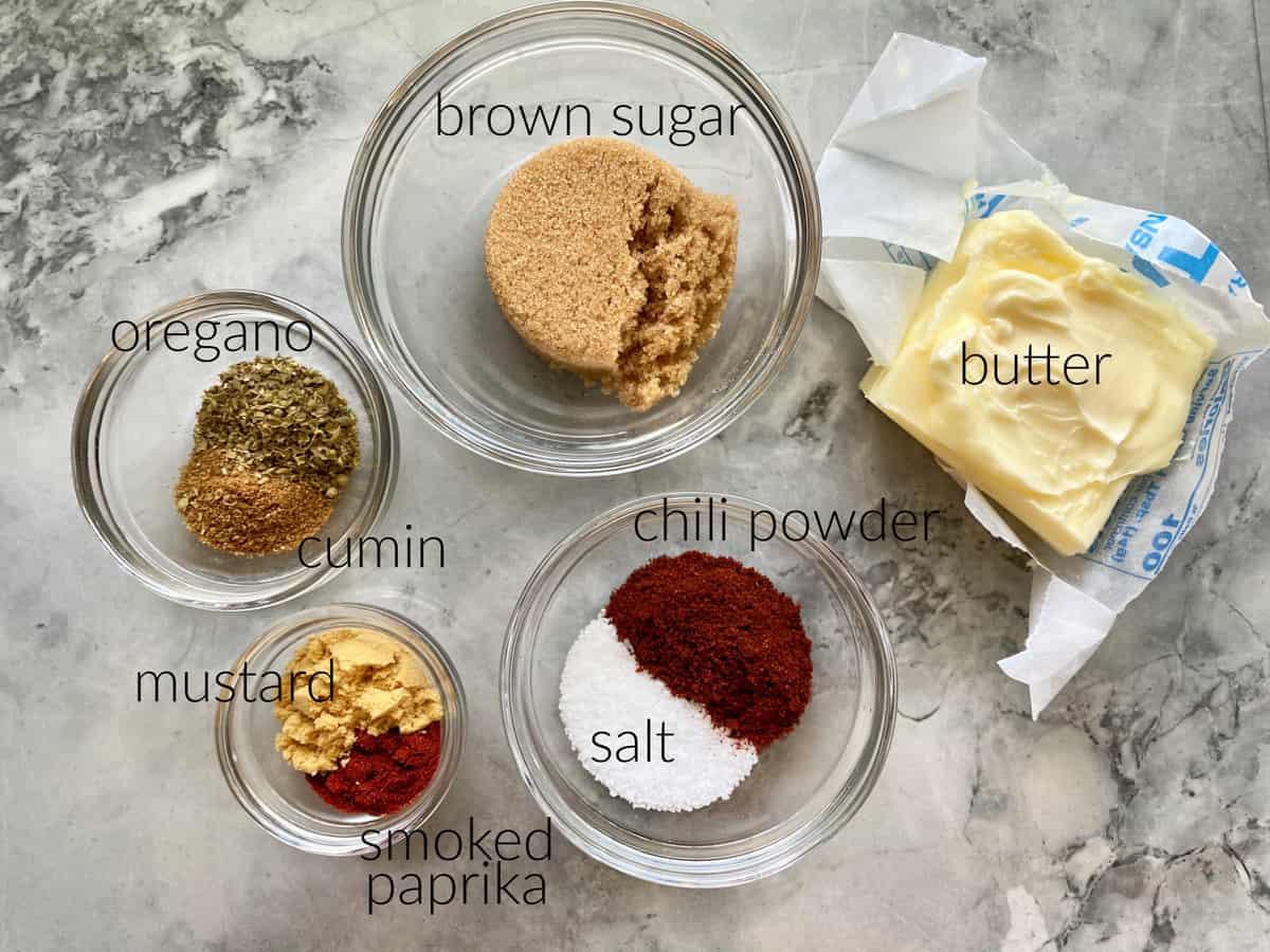 Ingredients: brown sugar, oregano, cumin, mustard, smoked paprika, salt, chili powder, and butter.