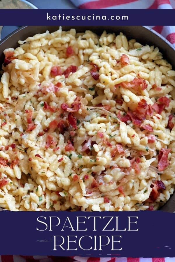 Top view of a skillet full of bacon and spaetzle with recipe title text on image.